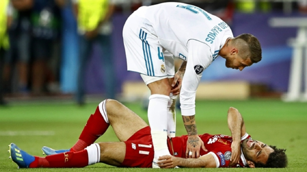 Sergio Ramos stands over Mohamed Salah.
