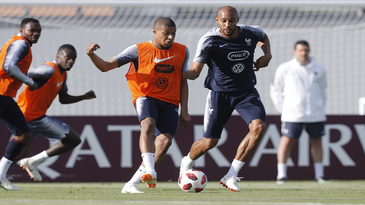 France's Kylian Mbappe controls the ball ahead of Stve Nzonzi during a training session at the 2018 football World Cup in Glebovets, Russia, Monday, July 2, 2018. (AP Photo/David Vincent).