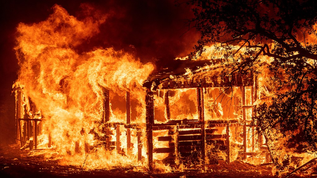 A structure burns as the Carr Fire races along Highway 299 near Redding, Calif., on Thursday, July 26, 2018. (AP Photo/Noah Berger)