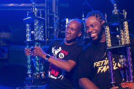 Sweet Soca King, Lil Rick (left) and Party Monarch King, Mikey (right) posing with their trophies.