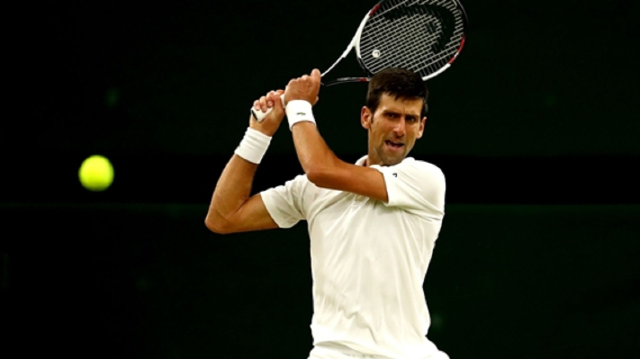 Novak Djokovic in action in the Wimbledon semi-finals.