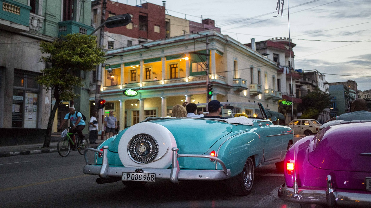 Tourists ride classic American convertibles in Havana, Cuba. AP Photo.