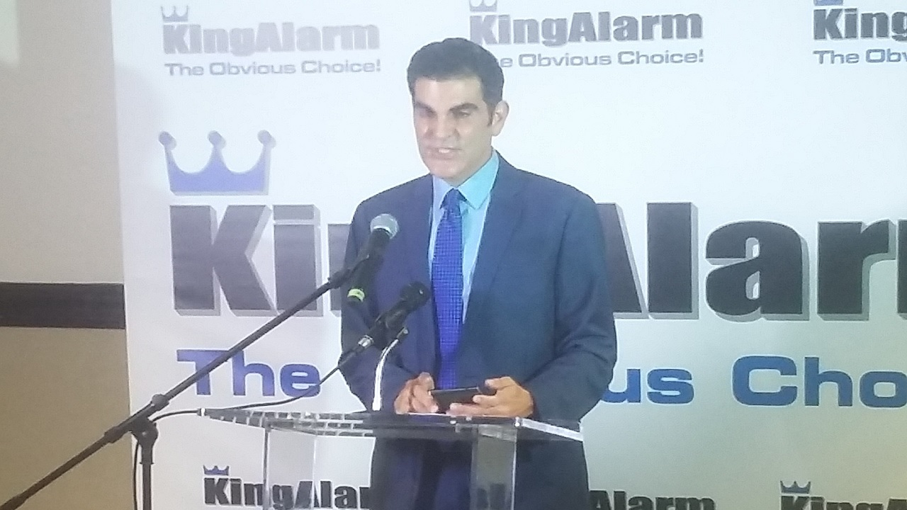 KingAlarm managing director, John Azar addresses journalists at a press conference on Thursday.