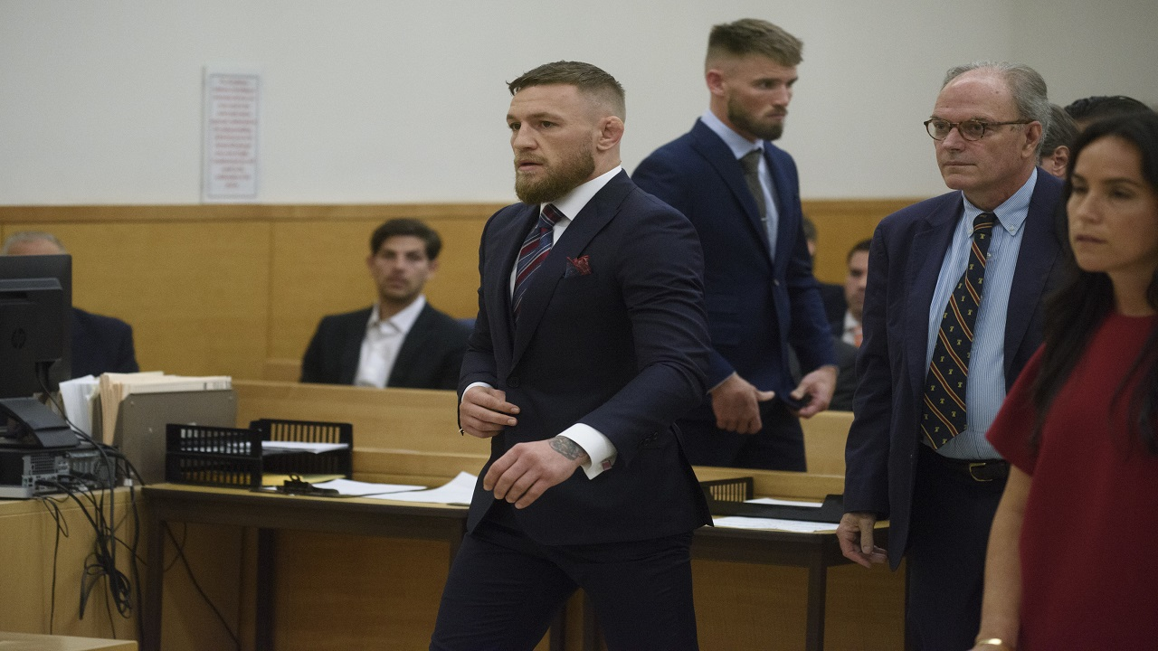 Mixed martial arts fighters Conor McGregor, center, and co-defendant Cian Cowley, third from left, appear in court, Thursday, July 26, 2018, in New York.