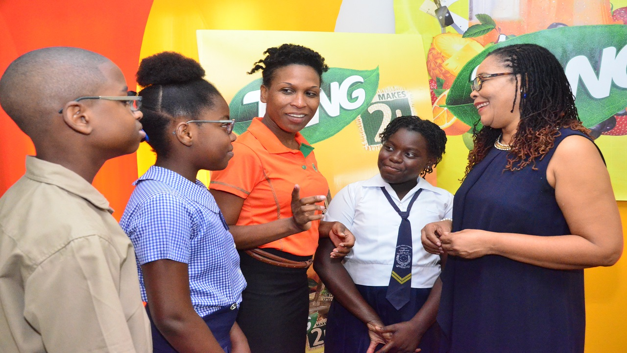 Simone McFarlane (centre), Brand Manager for TANG talk to scholarship awardees,  (left to right) Tai Grant, Black River Primary & Junior High; Khadedra John, South Borough Primary; Vittania Bedward, Mico Prastising Primary & Junior High and Dorrett Campbell, Deputy Chief Education Officer for the Ministry of Education, Youth and Information (MOEYI) about the importance of mathematics at the 2018 Tang GSAT Awards Luncheon.