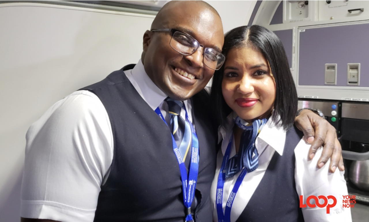 Alex and Suzeth on board the Copa Airlines inaugural flight while up in the air.