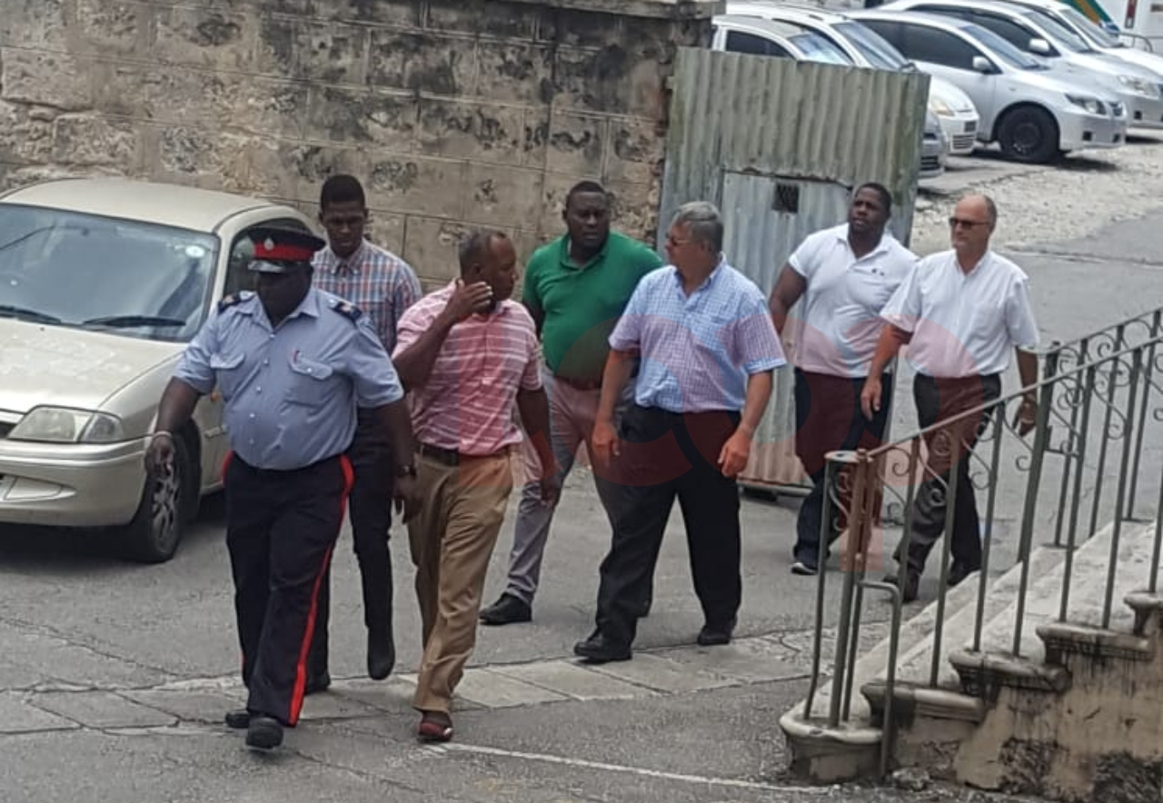 Walter Prescod, Christopher Rogers and Charles Herbert escorted to District A Magistrate's Court in Bridgetown moments ago. (July 27, 2018)