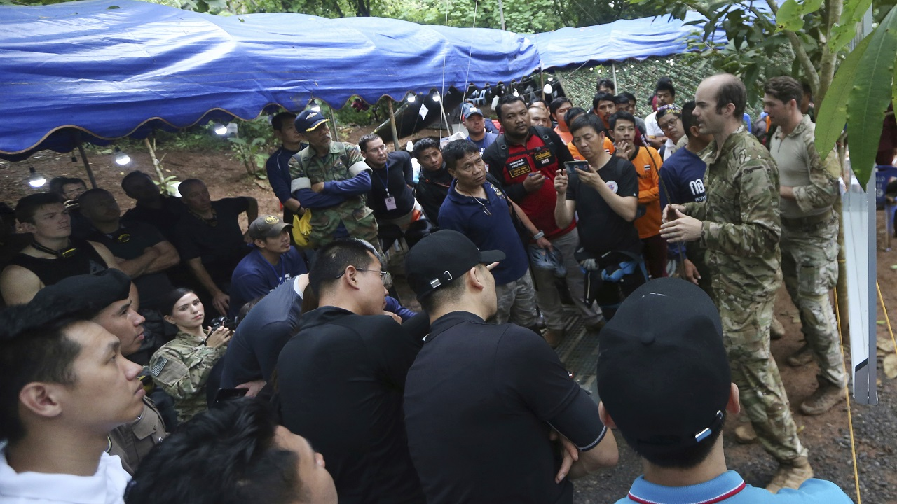 (Image: AP: Rescue workers at the cave on 2 July)
