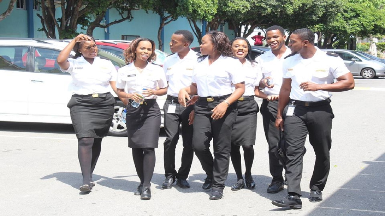 Happy faces among the student population  at the Caribbean Maritime University on the Palisadoes strip in Kingston.