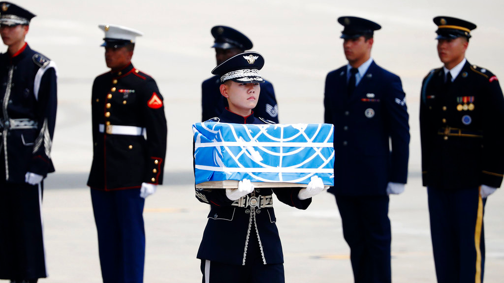 A soldier carries a casket containing a remain of a U.S. soldier who was killed in the Korean War during a ceremony at Osan Air Base in Pyeongtaek, South Korea, Friday, July 27, 2018. (Kim Hong-Ji/Pool Photo via AP)