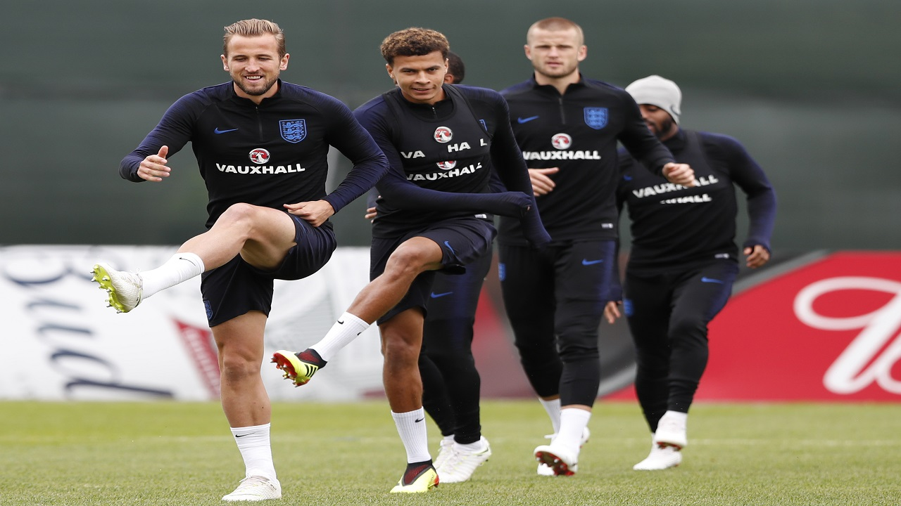 England's Harry Kane, left with England's Dele Alli, second left warm up prior to taking part in a training session for the England team at the 2018 World Cup, in the Spartak Zelenogorsk ground, Zelenogorsk near St. Petersburg, Russia, Saturday, June 30, 2018. (AP Photo/Alastair Grant)