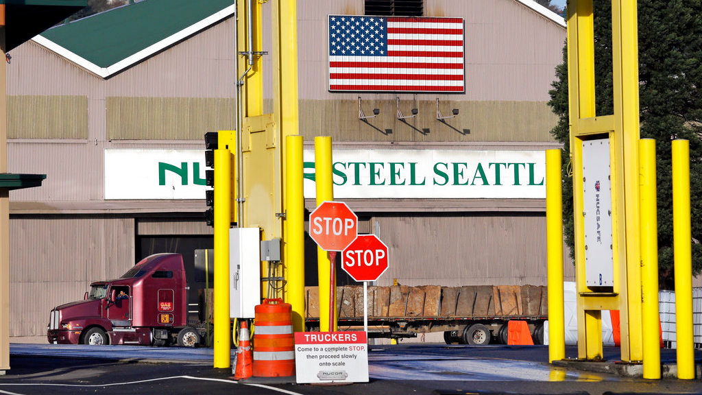 "In this Feb. 25, 2016 file photo, a truck carries a load at the Nucor Steel plant in Seattle. U.S. companies pursuing exemptions from President Donald Trump's tariff on imported steel are accusing American steel manufacturers of spreading inaccurate and misleading information, and they fear it may torpedo their requests. The president of one company calls objections raised by U.S. Steel and Nucor to his waiver request ""literal untruths.""(AP Photo/Elaine Thompson, File)"