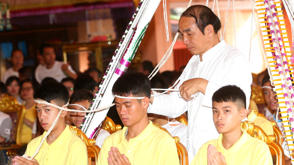 Photo: Soccer coach Ekkapol Janthawong, center, and members of the rescued soccer team attend a Buddhist ceremony that is believed to extend the lives of its attendees as well as ridding them of dangers and misfortunes in Mae Sai district, Chiang Rai province, northern Thailand, Thursday, July 19, 2018.