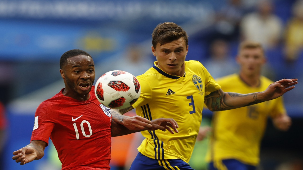 England's Raheem Sterling, right, challenges for the ball with Sweden's Victor Lindelof during the quarterfinal match between Sweden and England at the 2018 soccer World Cup in the Samara Arena, in Samara, Russia, Saturday, July 7, 2018. (AP Photo/Francisco Seco)