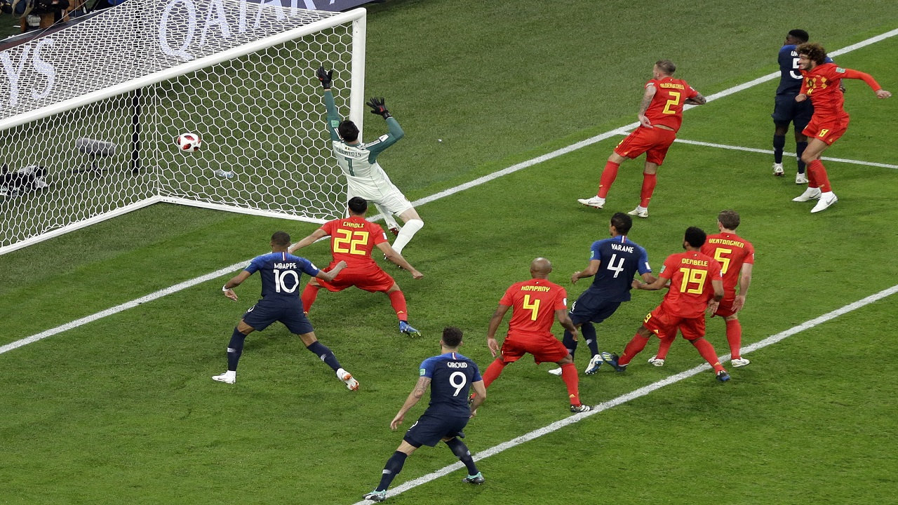 France's Samuel Umtiti, 2nd right, scores the only goal of the match during the semifinal game against Belgium at the 2018 football World Cup in the St. Petersburg Stadium in St. Petersburg, Russia, Tuesday, July 10, 2018. (AP Photo/Thanassis Stavrakis).