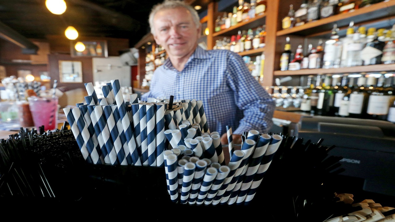 Paper straws sit at Duke Moscrip, owner of Duke's Restaurants, bar at his restaurant in Seattle