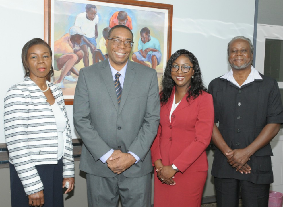 Minister of Creative Economy, Culture and Sports, John King, poses with awardee Chereda Grannum while Permanent Secretary in the Ministry, Deborah Payne (left) and Director of the Commission for Pan African Affairs, Deryck Murray (right) look on. (B.Hinds/BGIS)