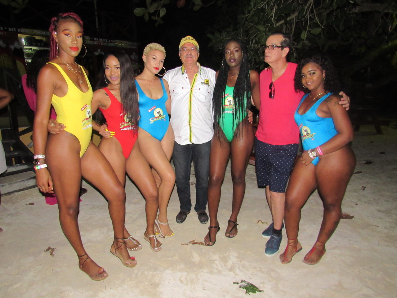 "CEO of Downsound Entertainment, Joe Bogdonovich (2nd right) and Reggae Sumfest Director, Robert Russell (centre) are joined by the ""Sumfest girls' at the ""Colour-Fest"" beach party on Sunday."