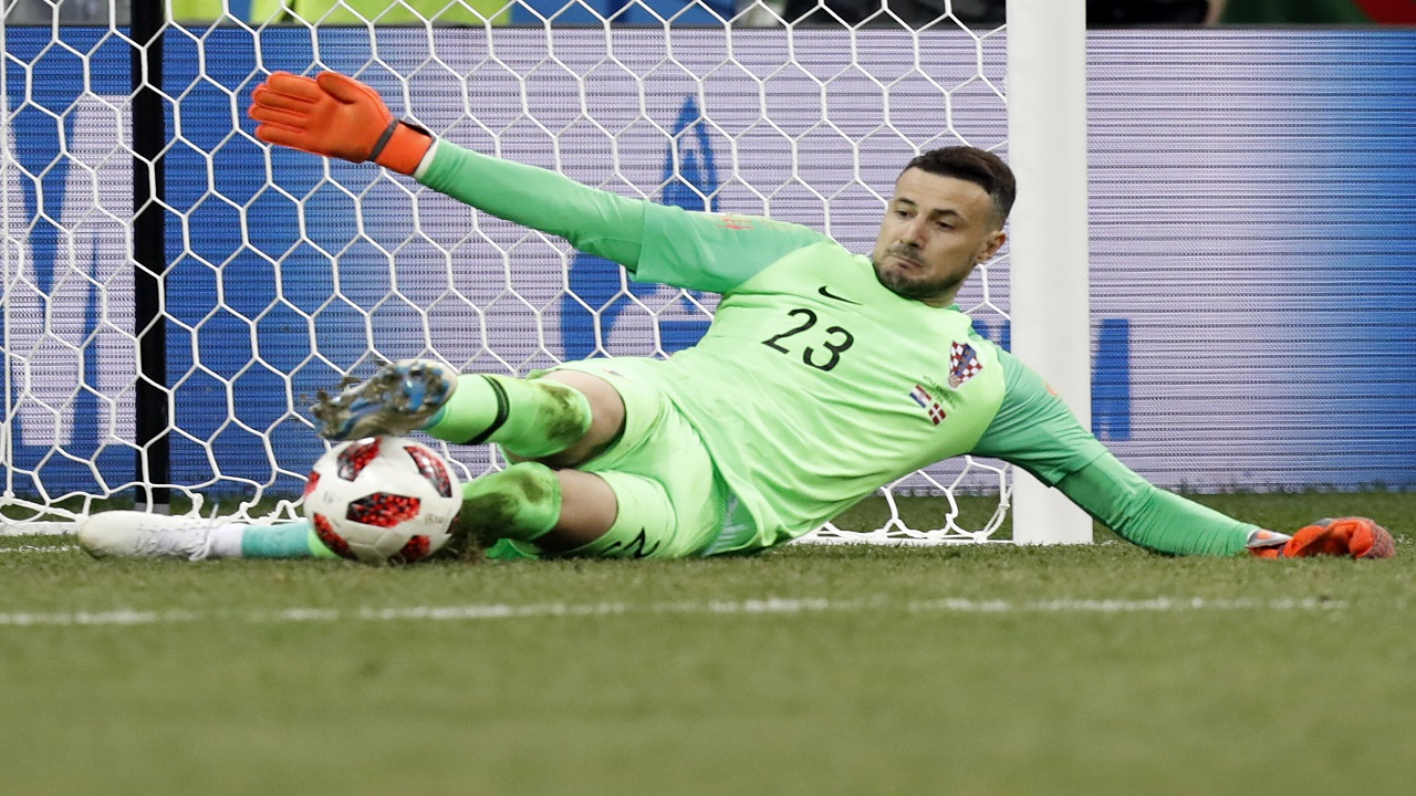 Croatia goalkeeper Danijel Subasic saves the decisive penalty during a penalty shoot out after extra time during the round of 16 match between against Denmark at the 2018 football World Cup in the Nizhny Novgorod Stadium, in Nizhny Novgorod , Russia, Sunday, July 1, 2018. (AP Photo/Efrem Lukatsky).