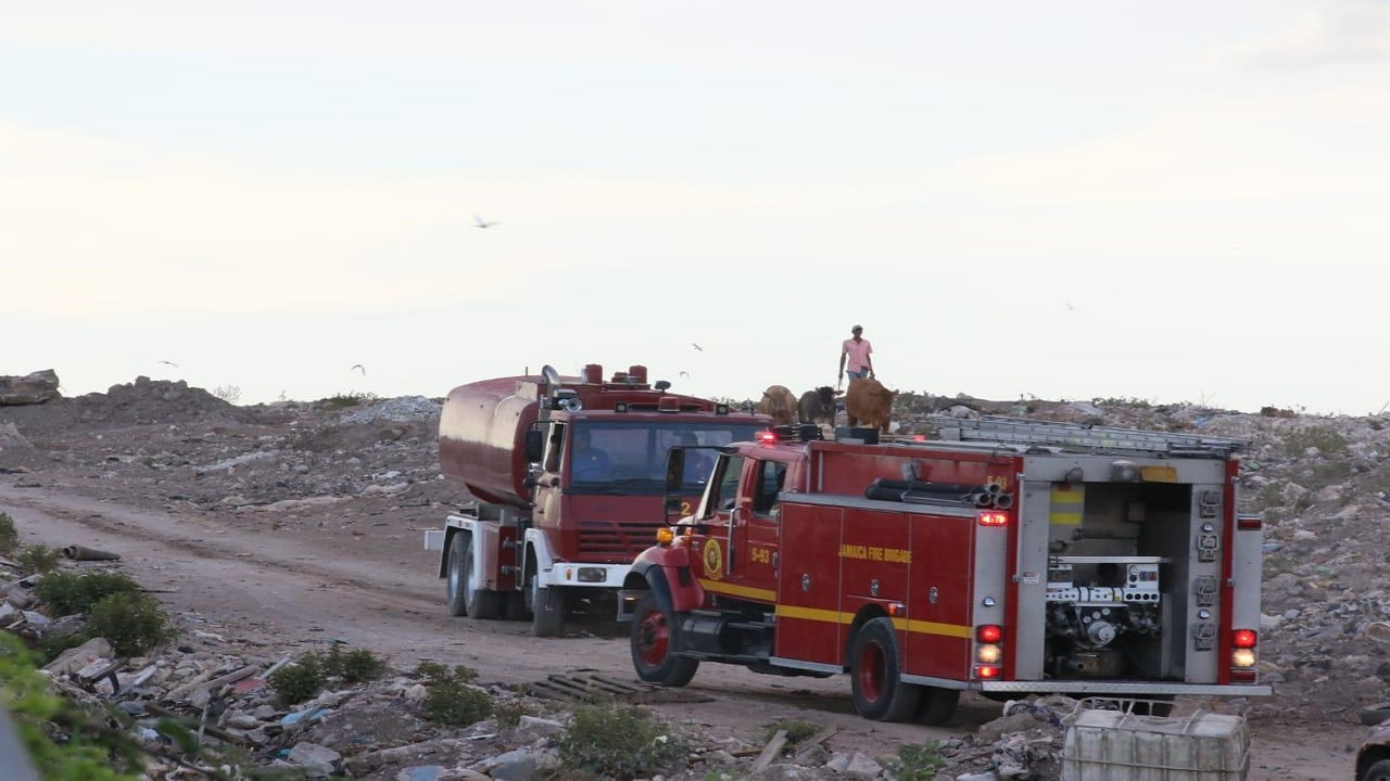 Fire brigade units and crews busy responding to the latest blaze at the Riverton City waste disposal site in St Andrew on Sunday.