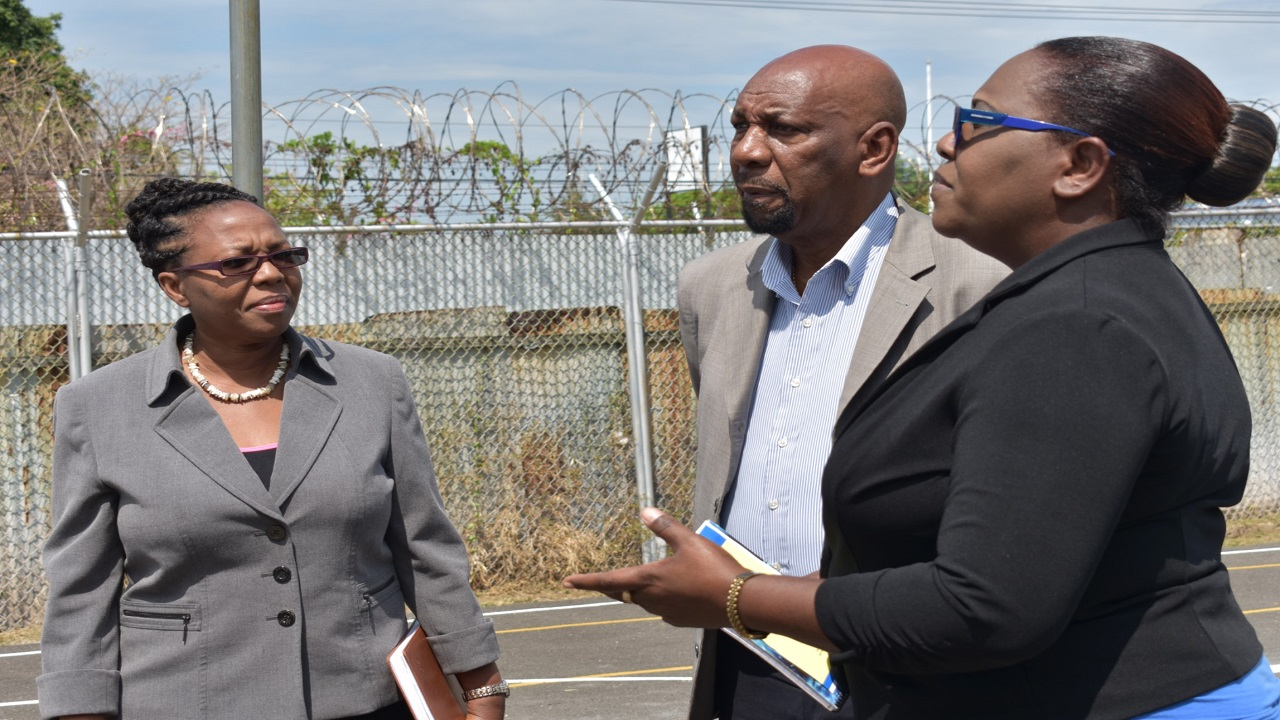 State Minister for National Security, Rudyard Spencer, in the company of officers of the ministry and the Department of Correctional Service on a recent tour of the South Camp Juvenile Rehabilitation Centre in St Andrew.