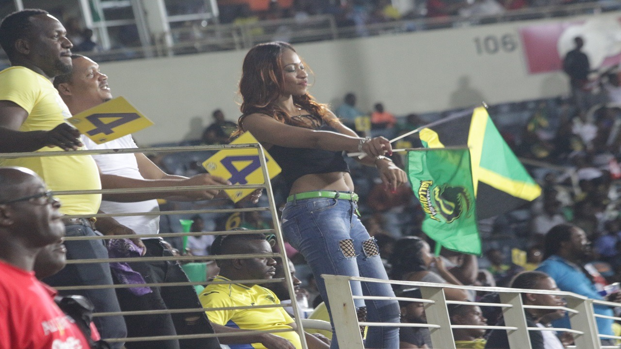 A Jamaica Tallawahs fan celebrates during the team's match against the St Lucia Stars on Friday. (PHOTOS: Marlon Reid)