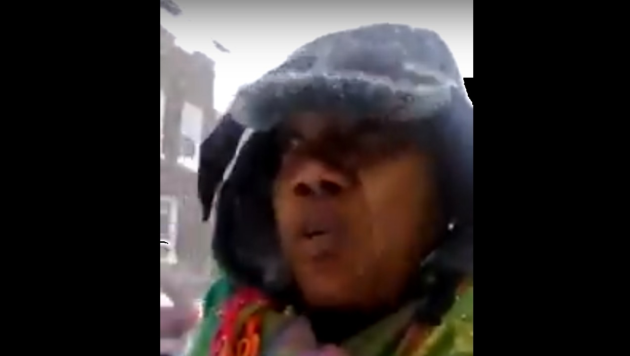 Screenshot of a viral video showing a Jamaican woman trudging through snow while expressing frustration with Jamaicans at home who pester those in the Diaspora for assistance.
