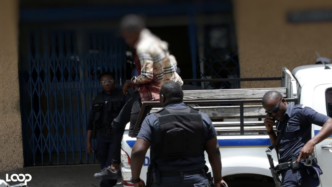 One of the alleged robbers who were shot in a reported shootout with the police in Half-Way Tree on Thursday, coming off a police vehicle at the Kingston Public Hospital.