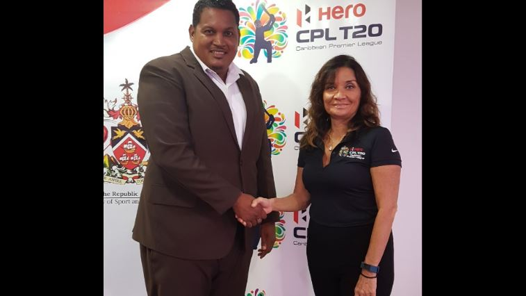 Darryl Smith, Minister of Sport and Youth Affairs greets Natalie Black-O'Connor, Branding and Hospitality Manager, CPL