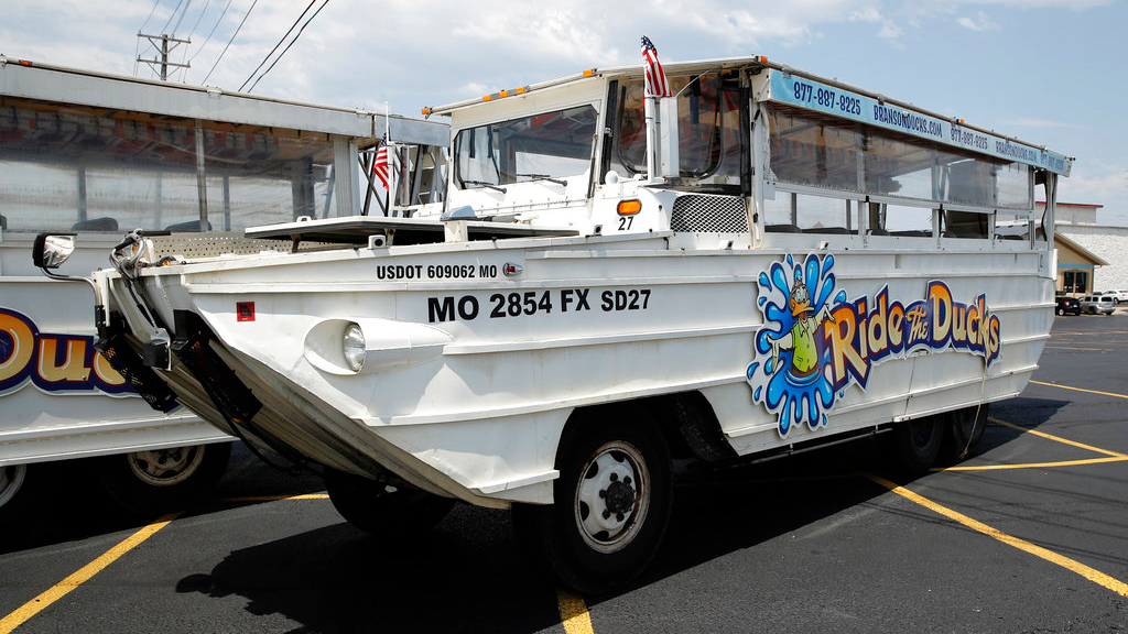 A duck boat sits idle in the parking lot of Ride the Ducks, an amphibious tour operator in Branson, Mo. Friday, July 20, 2018. The amphibious vehicle is similar to one of the company's boats that capsized the day before on Table Rock Lake resulting in 17 deaths. (AP Photo/Charlie Riedel)