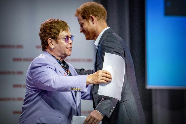Elton John et le prince Harry à la conférence sur le sida à Amsterdam le 24 juillet 2018