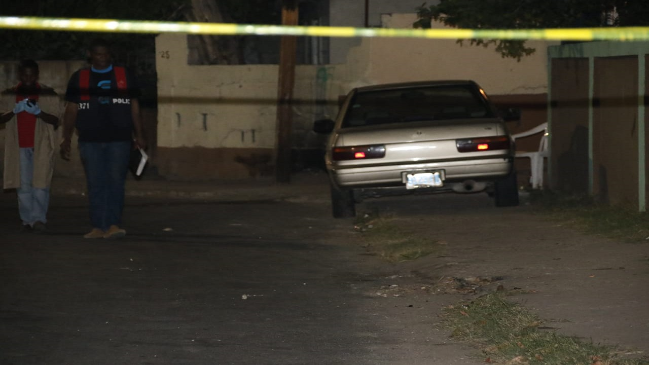 Police process the crime scene in Waterhouse on Tuesday night.