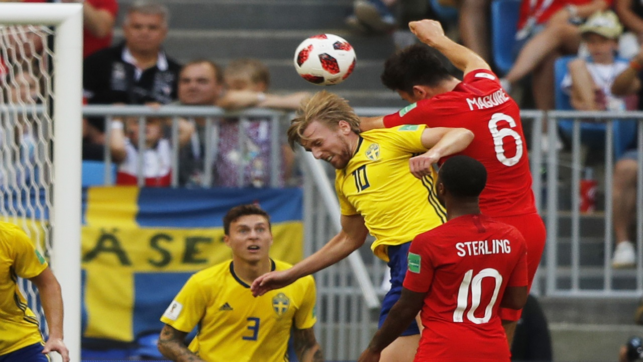 England's Harry Maguire, right above, scores his side's opening goal during the quarterfinal match against Sweden at the 2018 football World Cup in the Samara Arena, in Samara, Russia, Saturday, July 7, 2018. (AP Photo/Frank Augstein).