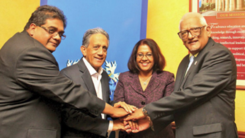 Dr Andy Bhagwandass (left) passed away on Saturday at the age of 47. Photo via the University of the  West Indies.
