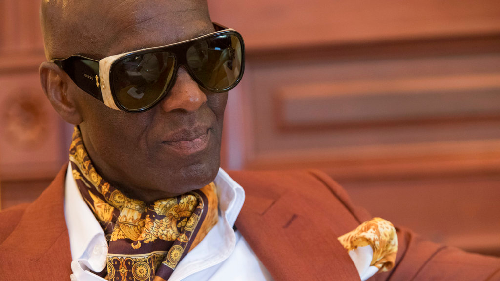 In this Thursday, July 19, 2018 photo, designer Dapper Dan is seen during an interview at his atelier in the Harlem neighborhood of New York. (AP Photo/Mary Altaffer)