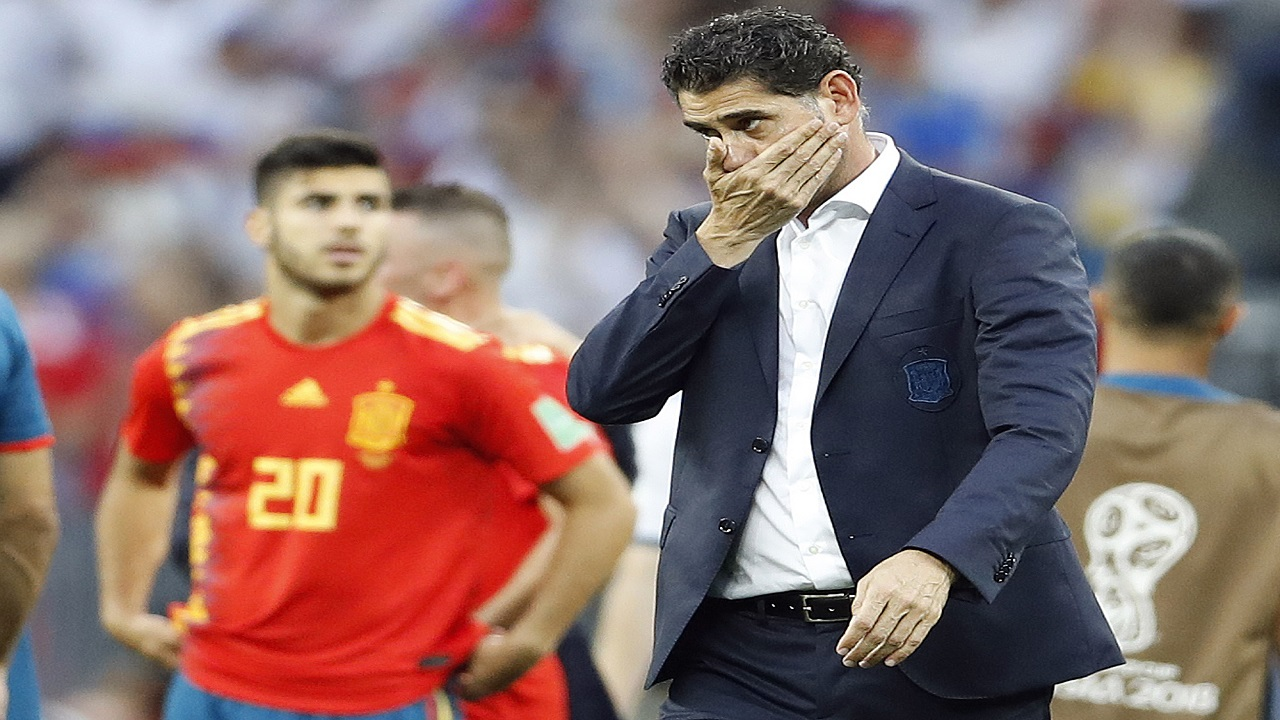 Spain head coach Fernando Hierro reacts after his team lost by penalty shootout during the round of 16 match between Spain and Russia at the 2018 World Cup at the Luzhniki Stadium in Moscow, Russia, Sunday, July 1, 2018. (AP Photo/Antonio Calanni)