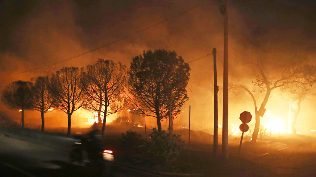 Buildings burn in the town of Mati, east of Athens, Monday, July 23, 2018. Regional authorities have declared a state of emergency in the eastern and western parts of the greater Athens area as fires fanned by gale-force winds raged through pine forests and seaside settlements on either side of the Greek capital. (AP Photo/Thanassis Stavrakis)