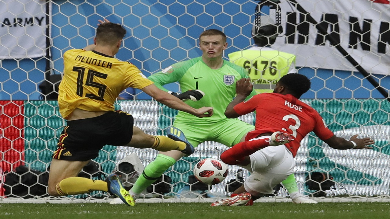 Belgium's Thomas Meunier, left, scores against England goalkeeper Jordan Pickford as England's Danny Rose tries to defend during the third place match at the 2018 football World Cup in the St. Petersburg Stadium in St. Petersburg, Russia, Saturday, July 14, 2018. (AP Photo/Petr David Josek).