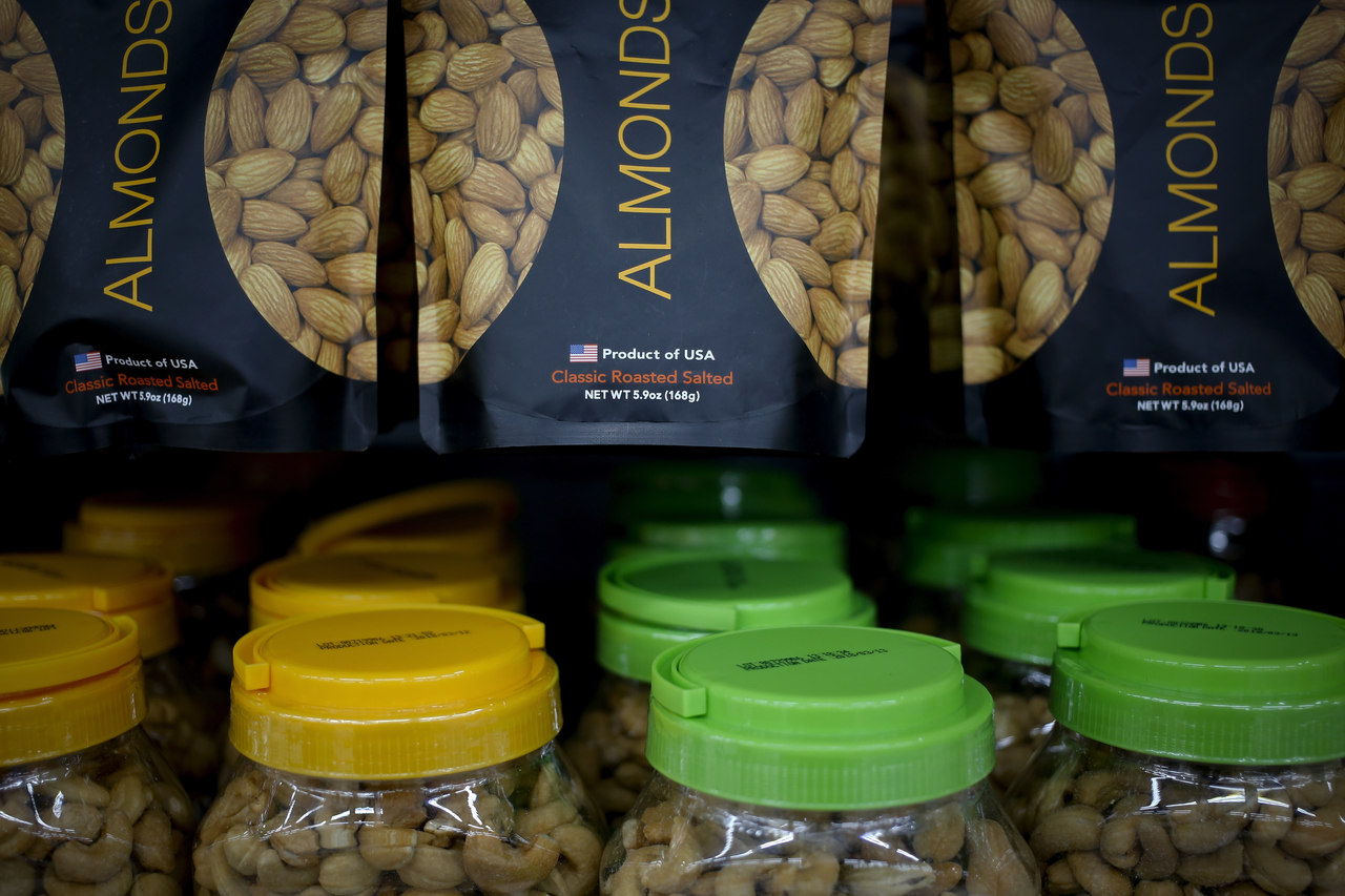 Imported nuts from the United States are displayed for sale at a hypermarket in Beijing. AP Photo.