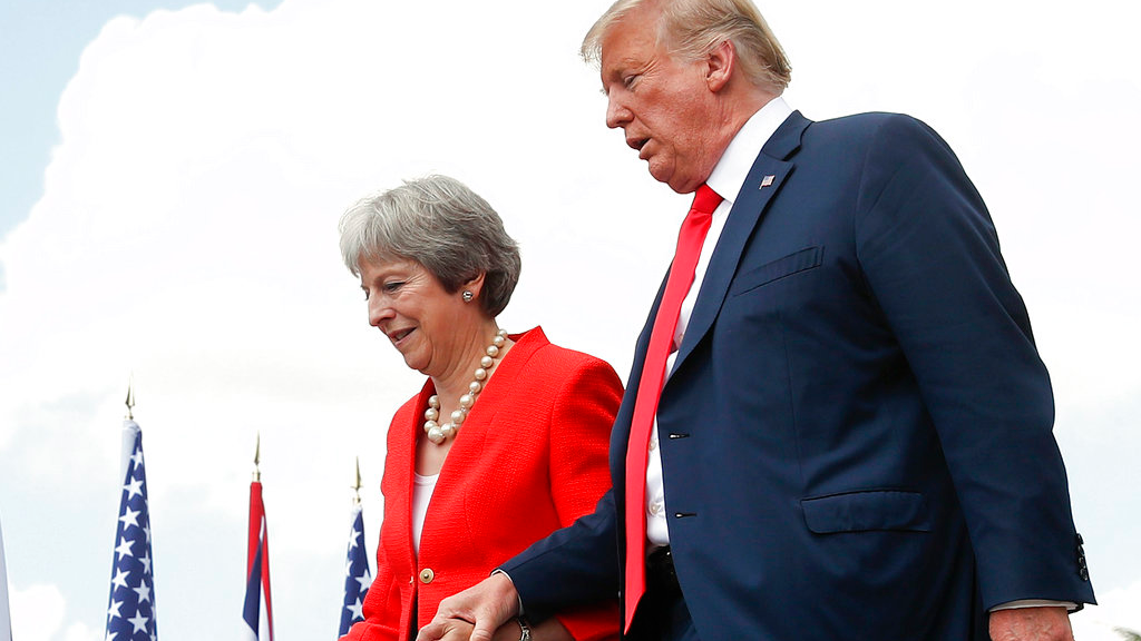 President Donald Trump and British Prime Minister Theresa May hold hands at the conclusion of their joint news conference at Chequers, in Buckinghamshire, England, Friday, July 13, 2018. (AP Photo/Pablo Martinez Monsivais)