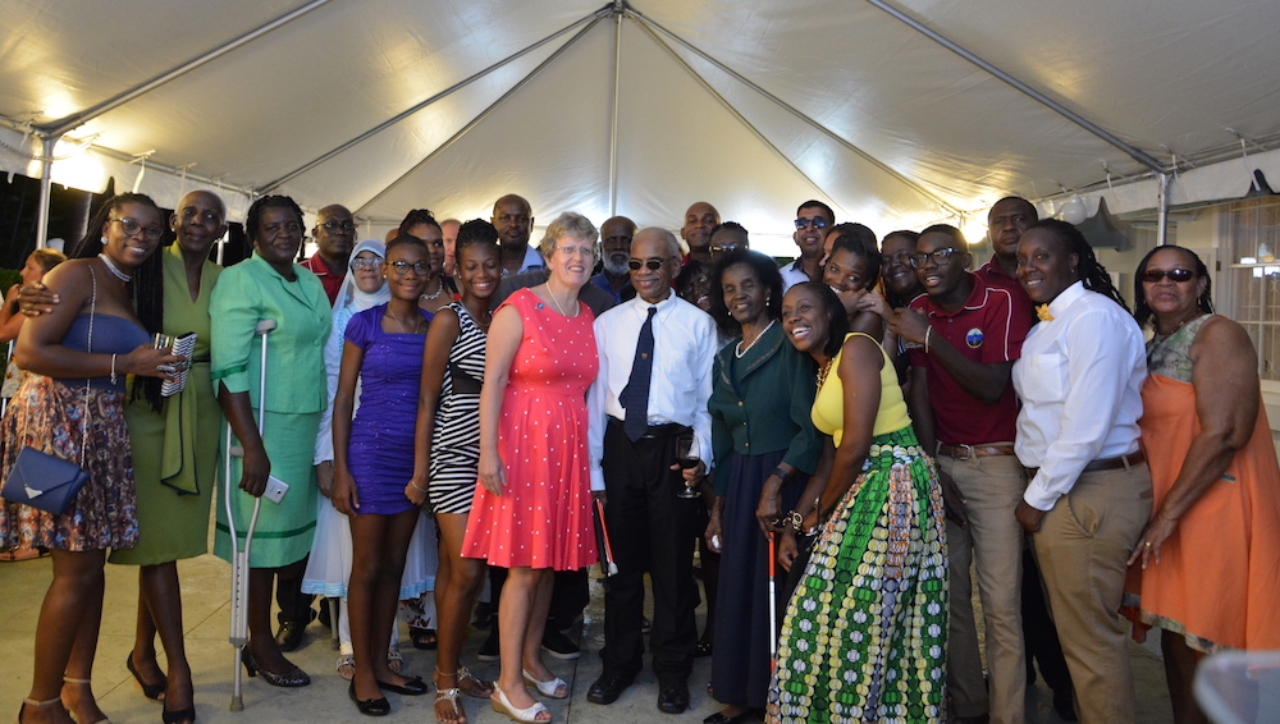 High Commissioner Janet Douglas and the West Indies visually impaired women's cricket team.