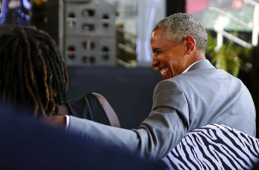 Former US President Barack Obama speaks with his half sister Auma Obama, in Kogelo, Kenya, Monday, July 16, 2018.
