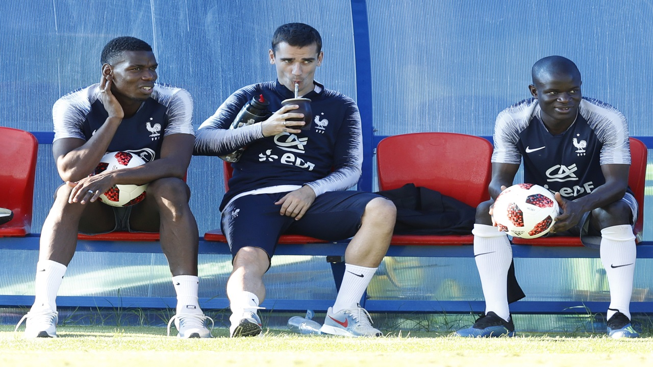 France's Paul Pogba, Antoine Griezmann and Ngolo Kante seat on the bench on during a training session at the 2018 football World Cup in Glebovets, Russia, Thursday, July 12, 2018. (AP Photo/David Vincent).