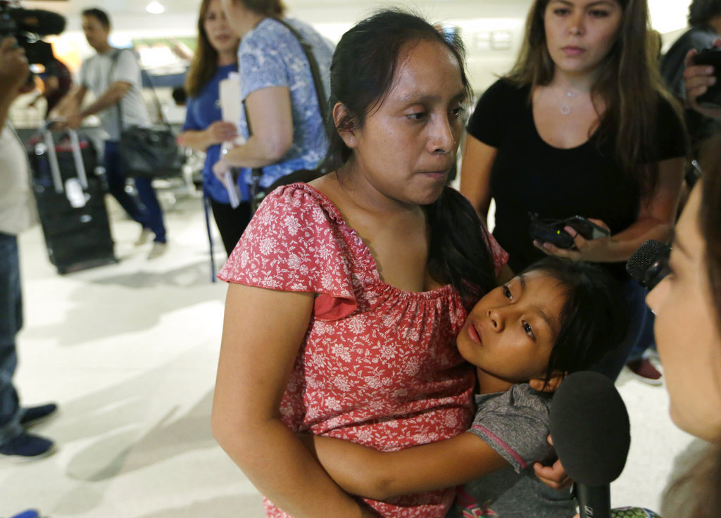 Buena Ventura Martin-Godinez, left, hugs her daughter Janne after being reunited at Miami International Airport, Sunday, July 1, 2018, in Miami. Martin crossed the border into the United States from Mexico in May with her son, fleeing violence in Guatemala. Her husband crossed two weeks later with their 7-year-old daughter Janne. All were caught by the Border Patrol, and were separated. Her daughter was released Sunday from a child welfare agency in Michigan. (AP Photo/Lynne Sladky)