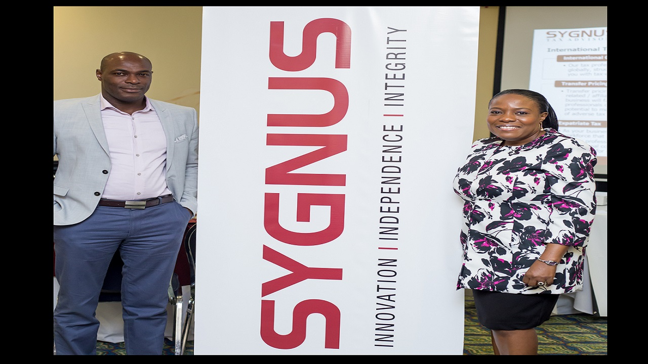 Sygnus Capital CEO Berisford Grey (left) and Dionnie A. Headley, Managing Director, Sygnus Tax at the inaugural Sygnus Tax Advisory Executive Tax Planning Forum.