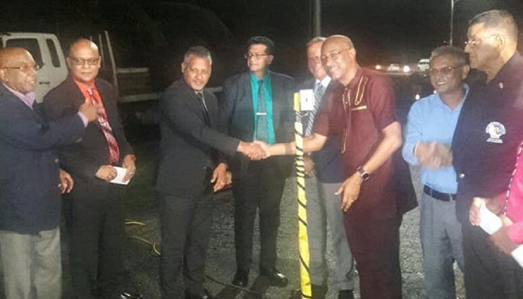 Photo: Minister of Agriculture, Lands and Fisheries shakes hands with Public Utilities Minister Robert le Hunte after the launch of a new solar lighting programme in Manzanilla started by Mayaro MP Rushton Paray.