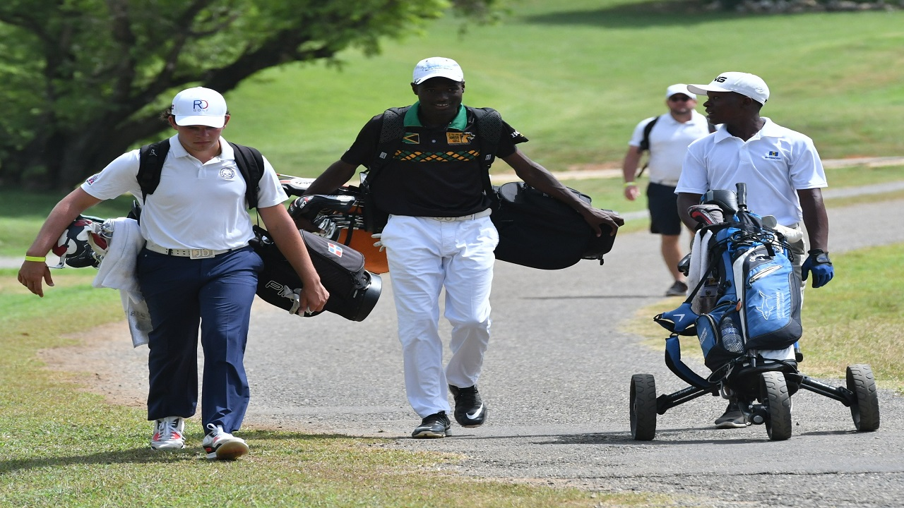 Juan Delgado of Dominican Republic (left)  Sebert Walker Jr (centre) of Jamaica and Xavier Wiggins of Barbados heading out during the opening day of the  2018 Caribbean Amateur Junior Golf Championship at Caymanas Golf Club in St Catherine on Wednesday.