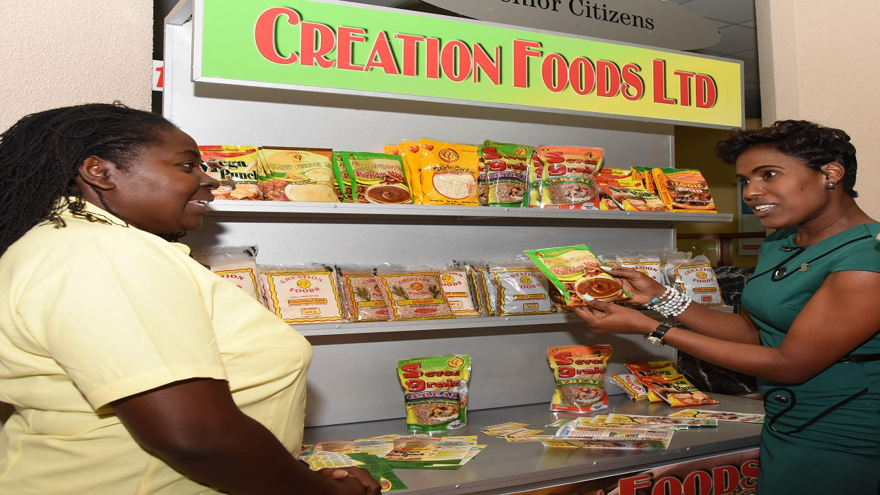 Kaysia Johnson Vaughn (right), marketing programmes manager at Scotiabank chats with Co-Owner of Creation Foods, Naomi Morris.