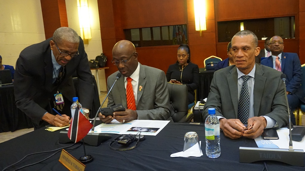 Photo: Prime Minister Dr Keith Rowley and Minister of Foreign and CARICOM Affairs, the Honourable Dennis Moses during the Second Plenary Business Session of the 39th Regular Meeting of Heads of Government of the Caribbean Community at the Montego Bay Convention Centre, Montego Bay Jamaica.