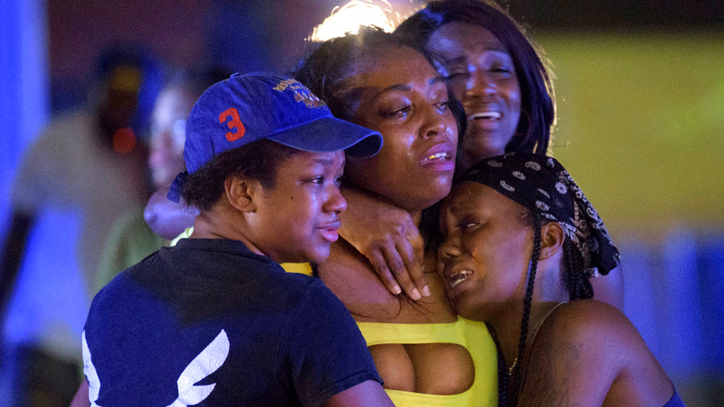 People react at the scene of shooting in New Orleans, Saturday, July 28, 2018. (Matthew Hinton /The Advocate via AP)